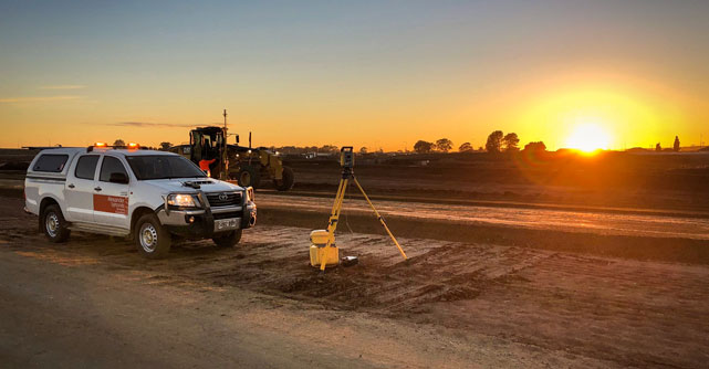 Alexander Symonds vehicle on worksite with sunset