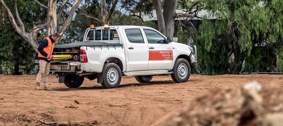 Alexander Symonds company car parked on dirt